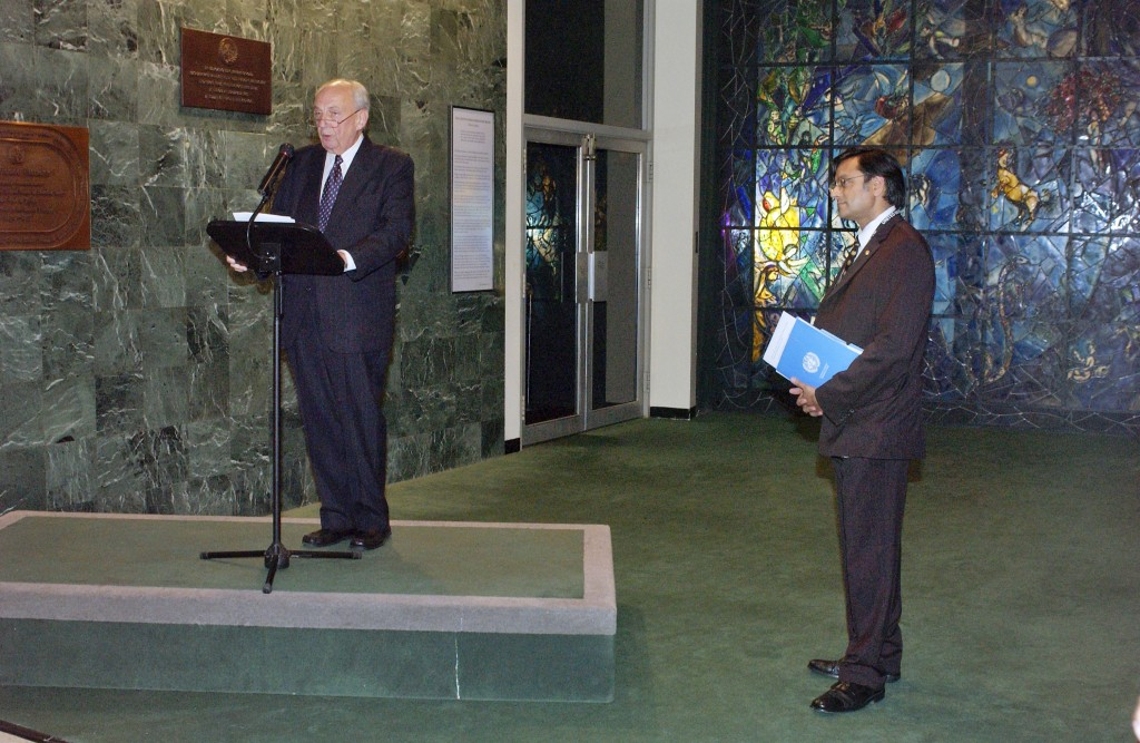 UN Photo/Paulo Filgueiras : Vladimir Petrovsky (left), former Director-General of the UN in Geneva and President of the Disarmament Conference, speaks at a ceremony to dedicate the completed restoration project of the Peace Window by Marc Chagall, which was installed at the United Nations in honour of Dag Hammarskjöld in 1964. Next to him is Shashi Tharoor, Under-Secretary-General for Communications and Public Information. The ceremony was part of the events held today to mark the 60th anniversary of the United Nations. 25 October 2005 United Nations, New York Photo # 100054